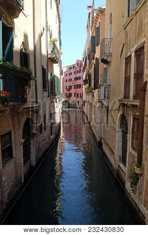 VENICE, ITALY - MAY 28: View of the beautiful and colorful small canals and historic buildings in Venice, Italy on May 28, 2017.