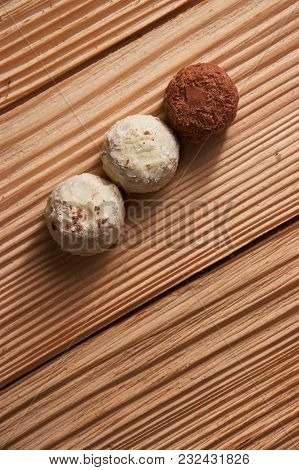 Chocolate Candies On Wooden Background. With Space For Text, Copyspace