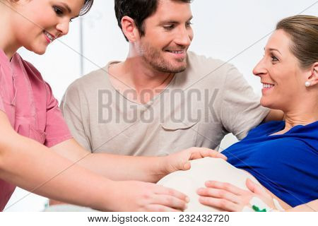 Pregnant woman and her man in delivery room of hospital