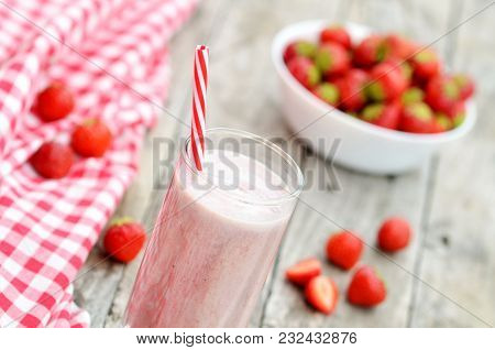 Strawberry Milkshake Smoothie Cocktail In The Glass With Straw, Fresh Strawberries And Red Checkered