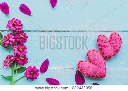 Top View  Of Pink Double Click Cosmos Flower With Handmade Pink Heart On Blue And White Color Wooden