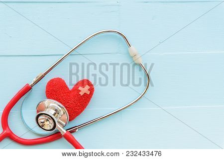 World Health Day, Healthcare And Medical Concept. Woman Hand Holding Red Heart With Stethoscope, Not