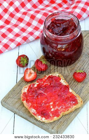 Jar Of Strawberry Jam, Fresh Strawberries And Toast Bread With Butter And Jam On White Table, Red Ch