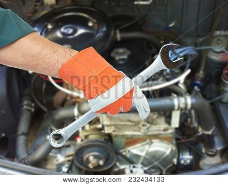 Motor Mechanic And Spanner. Service Center And Car Repair