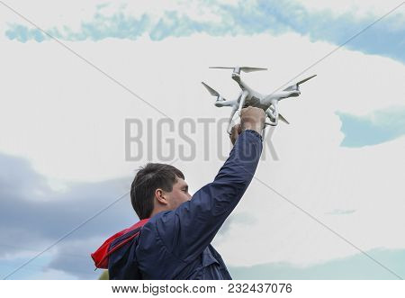 Field Next To Krasnodar, Russia - April 15, 2017: A Man With A Drone In His Arms Raised To The Sky.