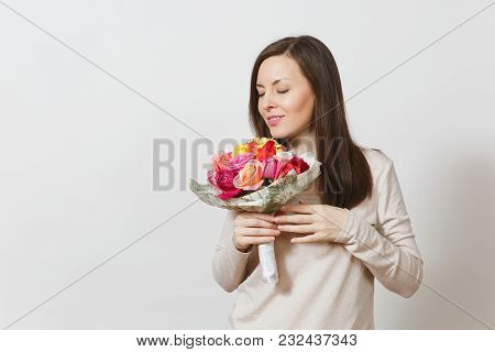 Young Smiling Woman Sniffing And Holding Bouquet Of Beautiful Roses Flowers Isolated On White Backgr