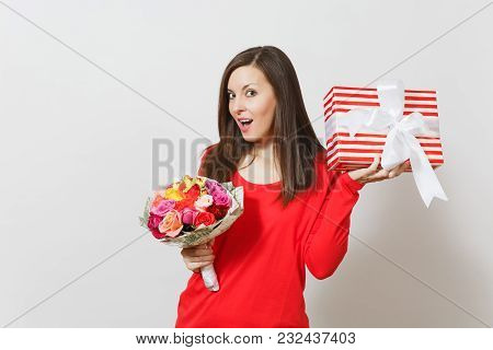 Young Pretty Woman In Red Clothes Holding Bouquet Of Beautiful Roses Flowers, Present Box With Gift
