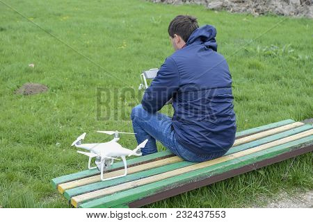 Field Next To Krasnodar, Russia - April 15, 2017: A Man With A Remote Control Drone In His Hands Is