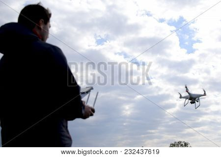 Field Next To Krasnodar, Russia - April 15, 2017: A Man With A Remote Control In His Hands. Controll