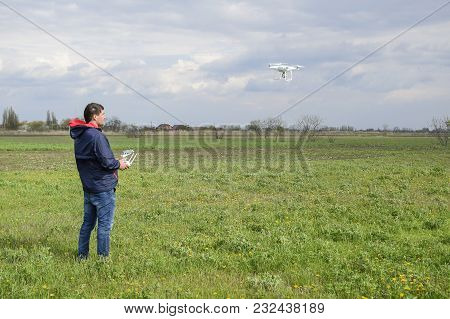 Field Next To Krasnodar, Russia - April 15, 2017: A Man With A Remote Control In His Hands. Flight C