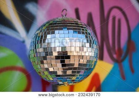 Mirror Disco-ball On A Colored Graffiti Background