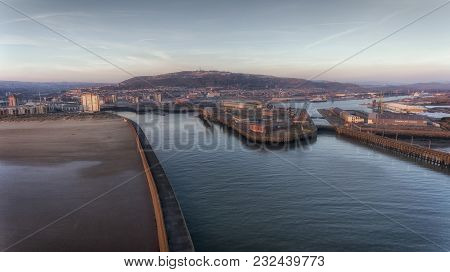 Editorial Swansea, Uk - February 24, 2018: The West And East Piers And Mouth Of The River Tawe At Th