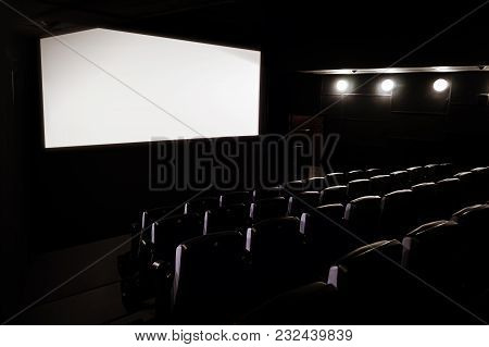 Cinema White Screen With Seats. Empty Cinema Without People. A Large White Screen To Show Movies. Fo