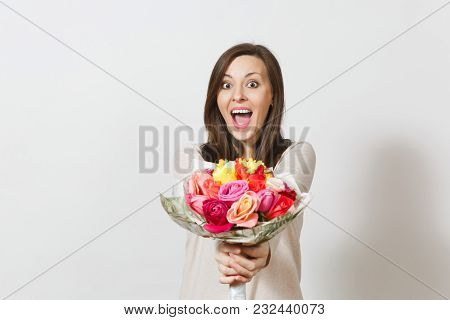 Young Smiling Woman Holding Bouquet Of Beautiful Roses Flowers Isolated On White Background. Copy Sp