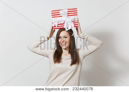 Fun Woman Holding Above Her Head Red Striped Present Box With Ribbon Isolated On White Background. F