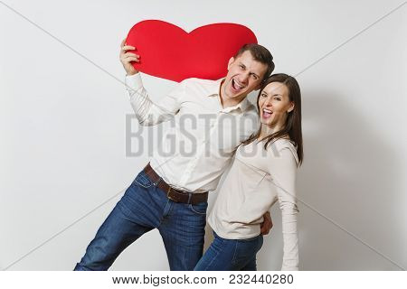 Couple In Love. Man And Woman With Big Red Heart Isolated On White Background. Copy Space For Advert