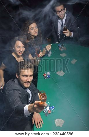 group of friends sitting at a casino table