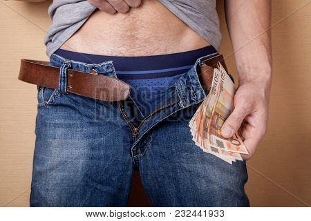 Concept Prostitution For Money. Man Takes Or Gives Money To The Euro For Intimacy Services. Brothel