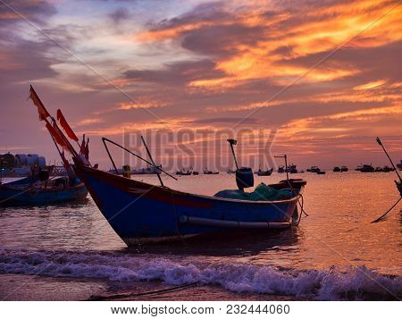 Old Fishing Boat In The Sea At Beautiful Sunset