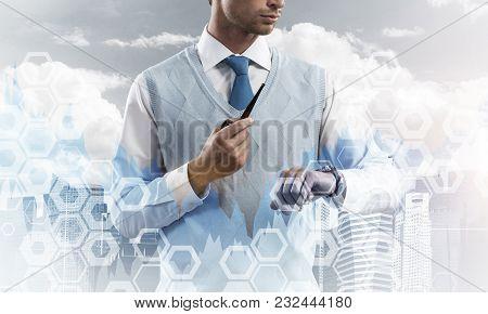 Double Exposure Of Confident And Young Businessman In Smart-casual Wear Smoking Pipe And Modern City