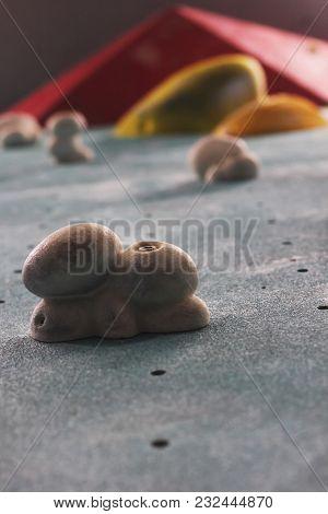 The Rock Climbing Practice Wall, Closeup. Vertical Photo, Selective Focus