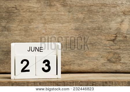 White Block Calendar Present Date 23 And Month June On Wood Background