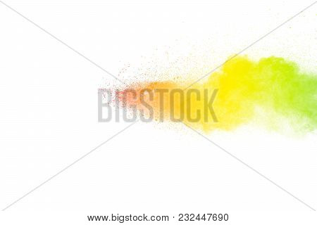 Freeze Motion Of Color Particles On White Background. Multicolored Granule Of Powder Explosion. Abst