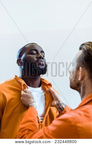 Prisoner Threatening African American Cellmate Isolated On White