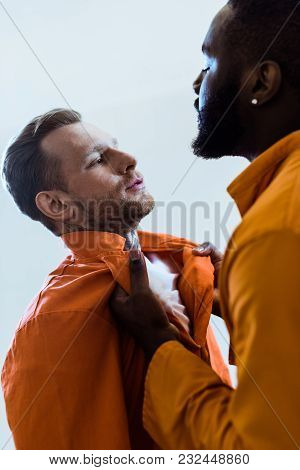 African American Prisoner Threatening Cellmate Isolated On White