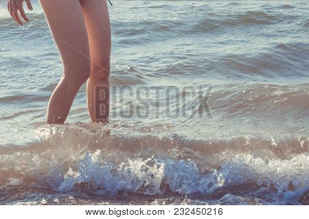 Close Up Of Woman Legs In Sea In Summer Holidays. Vacation Concept.