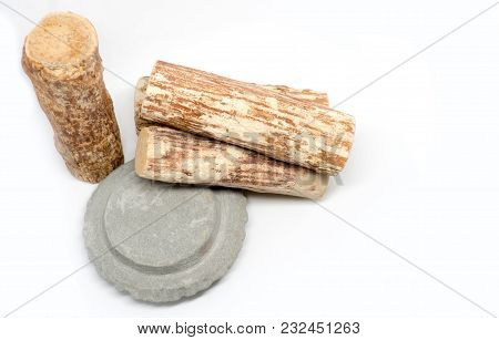 Thanaka Wood And Kyauk Pyin Stone Slab On White Background (isolated Background). The Tanaka Is Popu