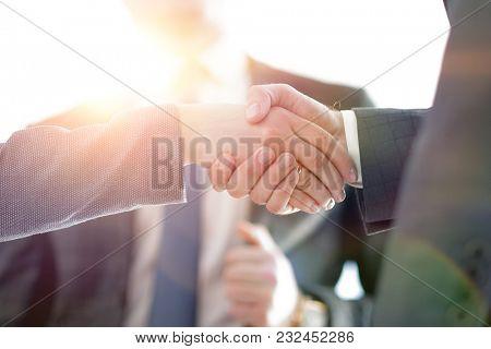 closeup of a business handshake partners.