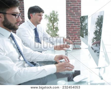 employee of the company types the text on the PC keyboard