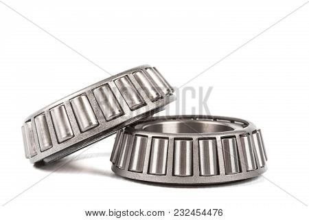 Two Precision Metal Bearings On A White Background.