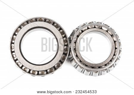 Two Precision Metal Bearings On A White Background. Top View.