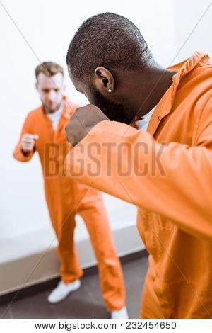 View Of Multiethnic Prisoners Fighting In Prison Cell