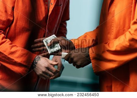 Cropped Image Of Prisoner Buying Drugs At African American Inmate