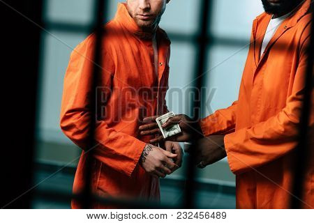 Cropped Image Of Prisoner Buying Drugs At African American Inmate In Prison Cell