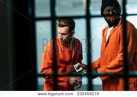 Prisoner Buying Drugs At African American Inmate In Prison Room