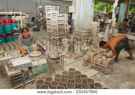 Kuching, Malaysia - August 27, 2009: Unidentified Men Work With Kaolin For Traditional Souvenirs Pro
