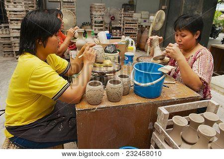 Kuching, Malaysia - August 27, 2009: Unidentified Women Cut Traditional Tribal Tattoo Motives Decora