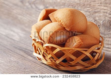 Ligth Homemade Breakfast From Fresh Cookies In Wicker Basket On Wooden Background. Rustic Concept
