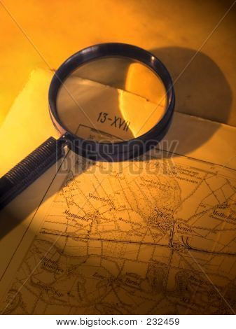 A Magnifier On An Old Map