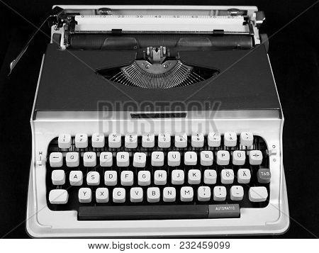 Isolated Vintage Manual Portable Typewriter With Plastic Keys