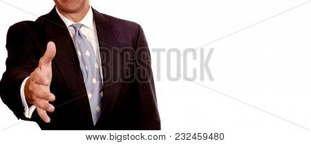 Friendly Business Man extends his hand on white