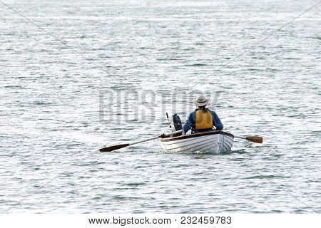 Person Rowing In San Francisco Bay. Rowing. Rowing Just Might Be The Most Efficient Exercise.