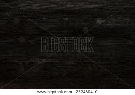Black Wooden Board Surface Background Top View.