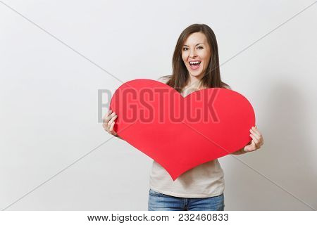 Beautiful Young Smiling Woman Holding Big Red Heart In Hands Isolated On White Background. Copy Spac
