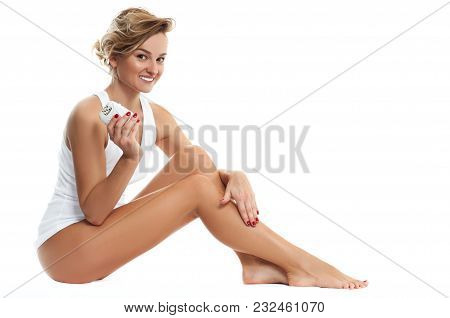 Woman Epilates Her Leg With An Electric Epilator Device. Smooth Skin After Depilation