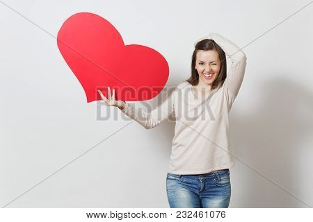 Pretty Fun Young Smiling Woman Holding Big Red Heart In Hands Isolated On White Background. Copy Spa
